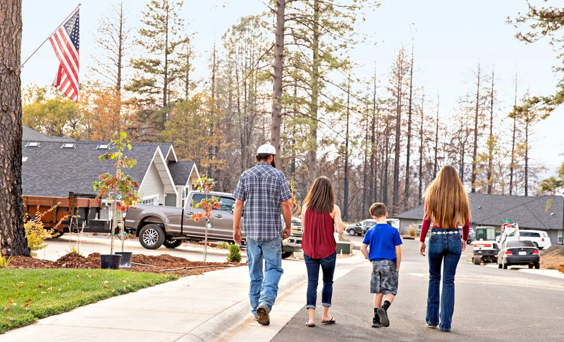 Paradise, CA family walking down the street