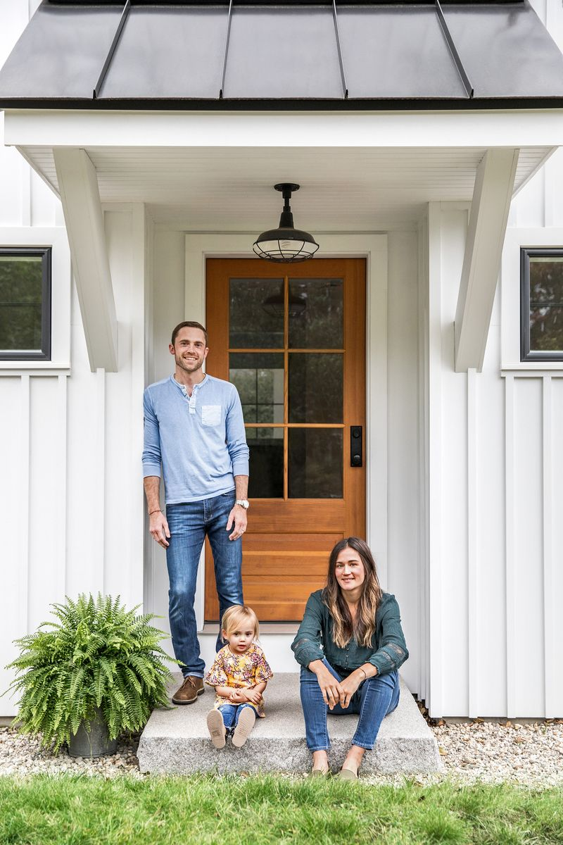 a Cape Cod-style remodel in Cumberland Foreside, ME, Wesley and Sarah Madeira Day, with daughter Elle at the front entry