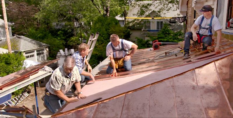 Tom Silva and Kevin O'Connor get an up-close look at the standing-seam portico roof installation, July/Aug 2020